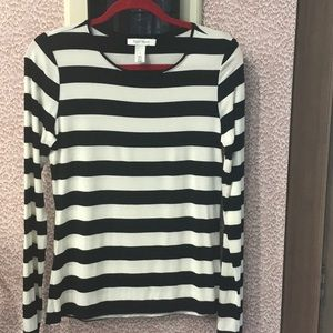 Long-sleeve black/white striped, dressy t-shirt.